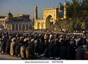 stock-photo-kashgar-china-oct-thousands-of-muslim-worshipers-kneel-on-prayer-carpets-outside-of-id-kah-29776708[1]